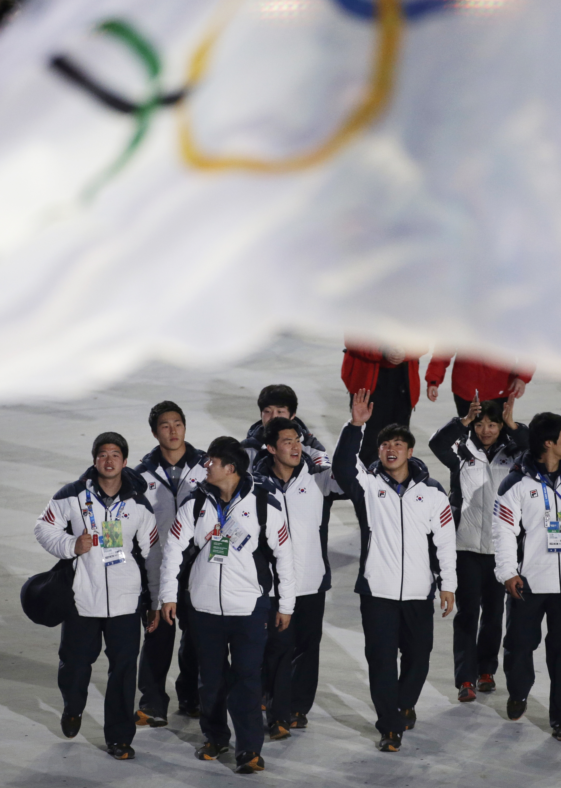 South Korean athletes enter the arena during the closing ceremony of the 2014 Winter Olympics, Sunday, Feb. 23, 2014, in Sochi, Russia. (AP Photo/Gregorio Borgia)