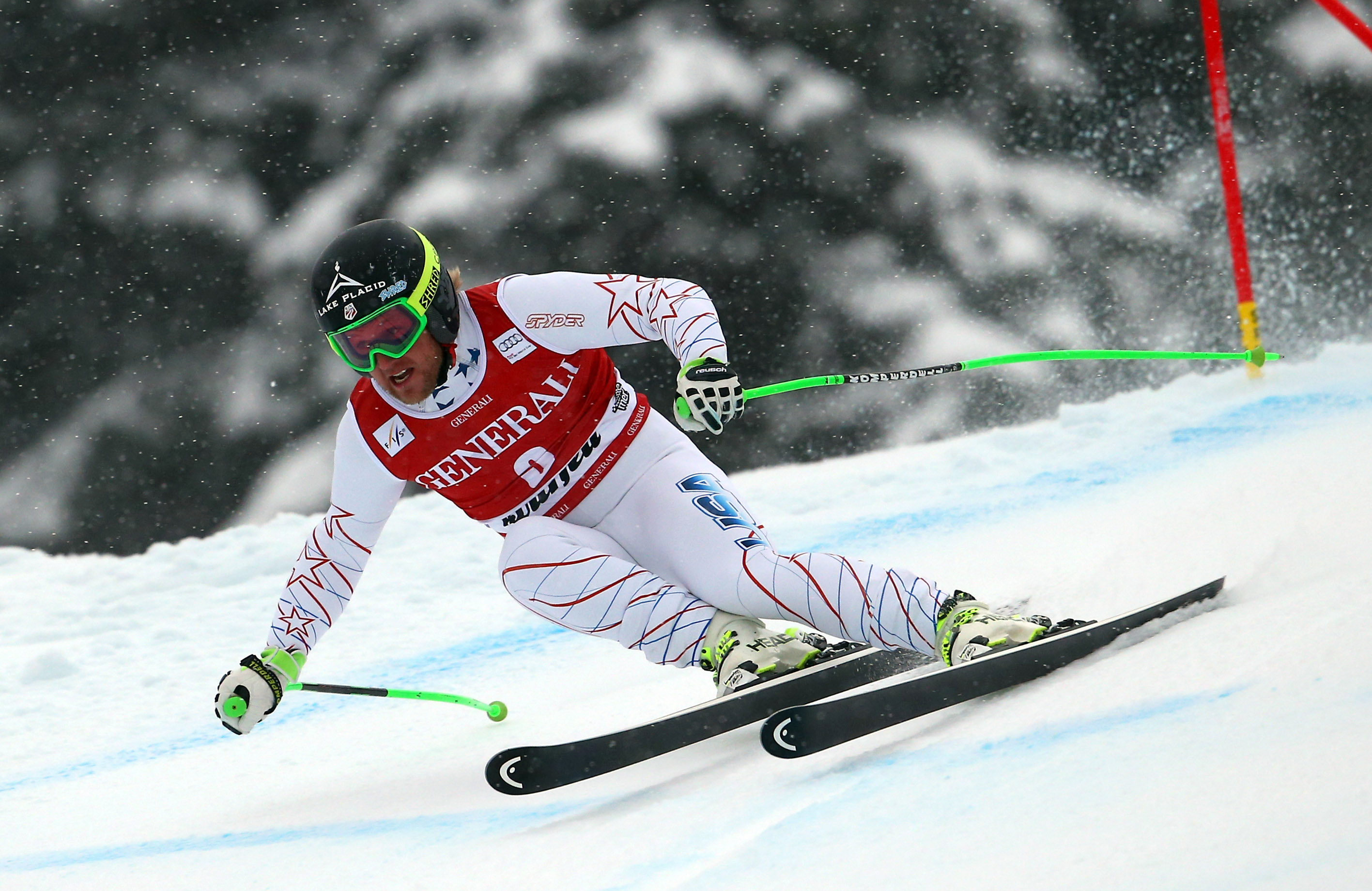 Andrew Weibrecht, of the US, speeds down the course during an alpine ski, men's World Cup super-g, in Kviitfjell, Norway, Sunday, March 2, 2014. (AP Photo/Alessandro Trovati)