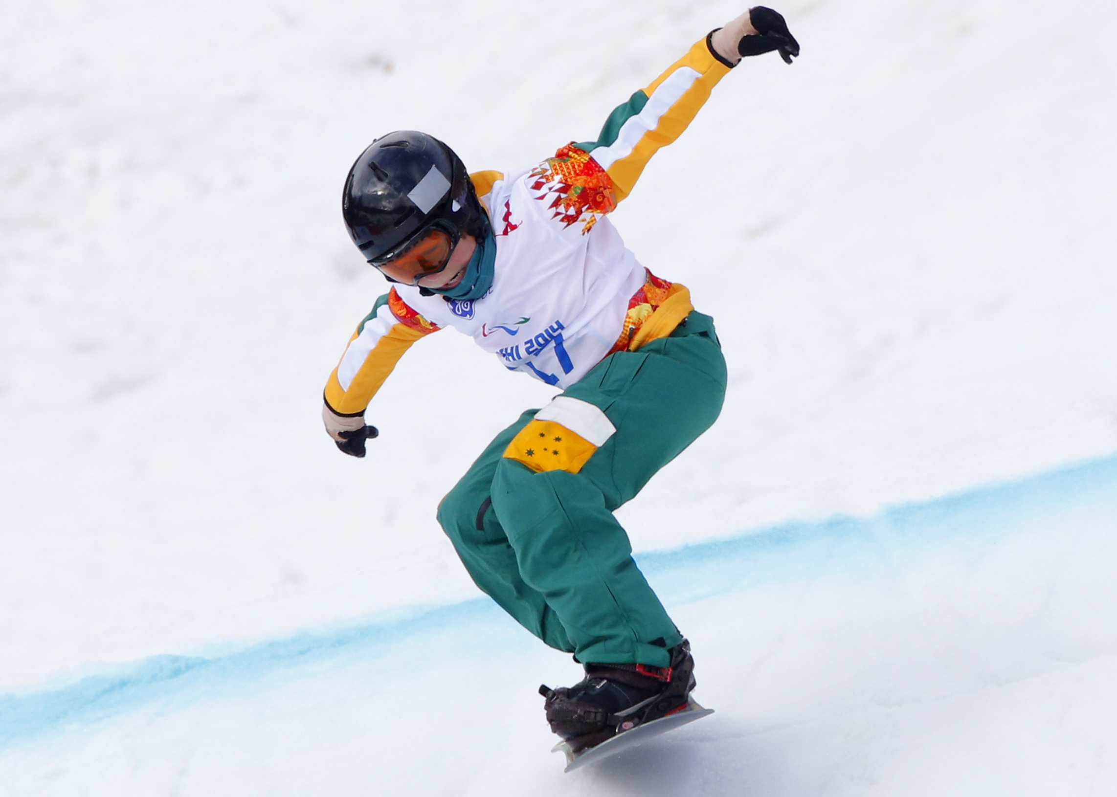 Ben Tudhope of Australia competes during the men's para-snowboard cross, standing event at the 2014 Winter Paralympic, Friday, March 14, 2014, in Krasnaya Polyana, Russia. (AP Photo/Dmitry Lovetsky)