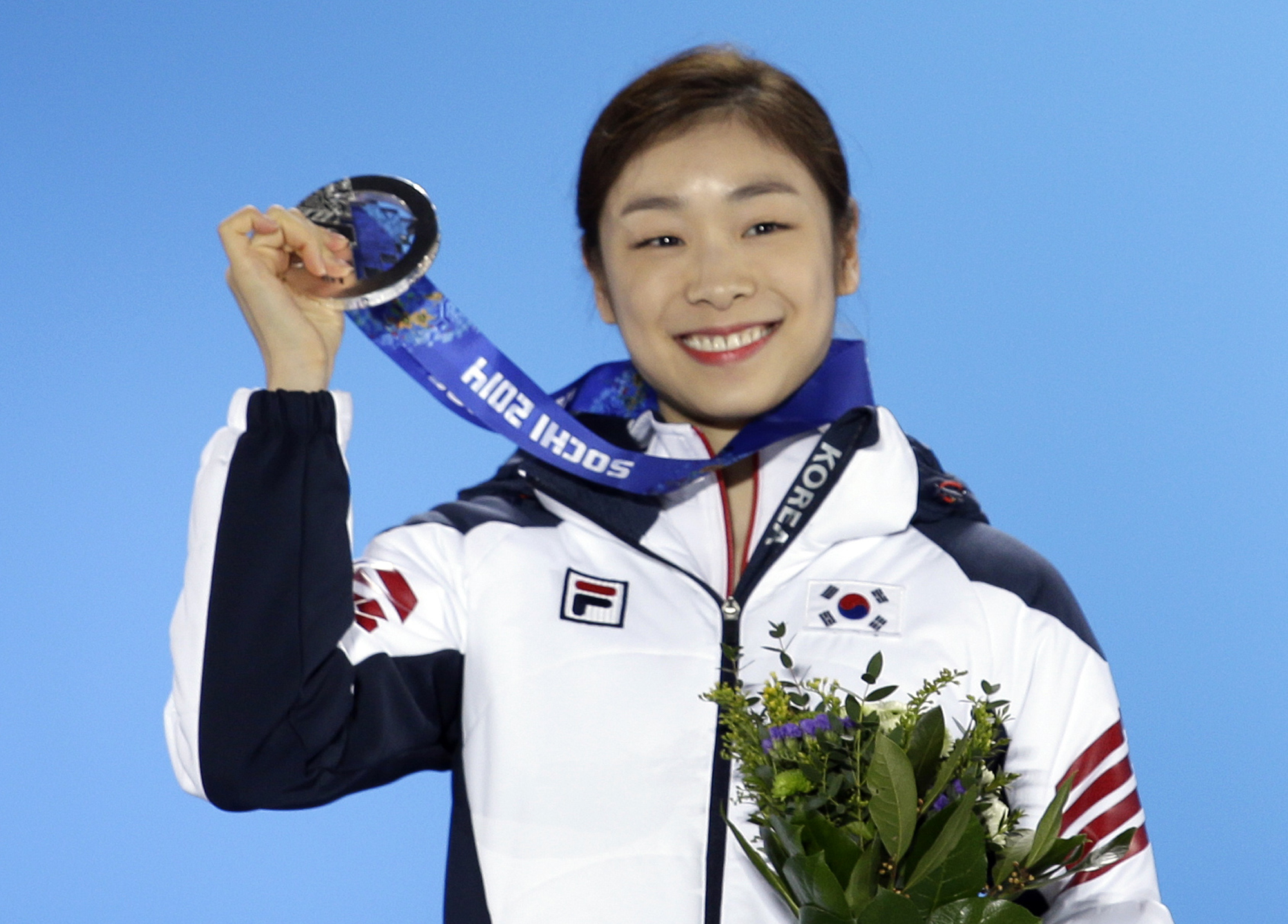 FILE - In this Feb. 21, 2014 file photo, women's free skate figure skating silver medalist Yuna Kim of South Korea smiles during the medals ceremony at the 2014 Winter Olympics, in Sochi, Russia. South Korean sports officials said Tuesday, March 25, 2014, they are preparing to file a formal complaint with the International Skating Union over the judging of the women's figure skating competitions at the Sochi Olympics. Many South Koreans allege that questionable judging denied Kim a second straight figure skating gold medal. (AP Photo/David Goldman, File)