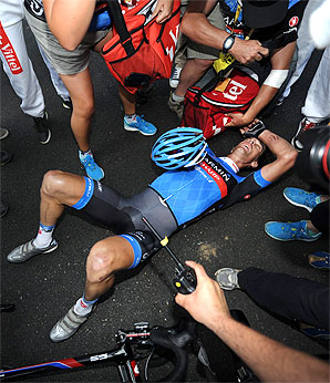 David Millar collapsed on the ground after his sprint to win stage 12, but reporters and cameramen continued to hound him.