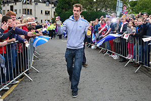 Andy Murray walked slowly through Dunblane's streets as the crowds chanted his name, waved Scottish flags and lifted homemade placards.