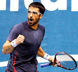 Janko Tipsarevic's victory over Fernando Verdasco puts him into the semis against Gilles Simon.