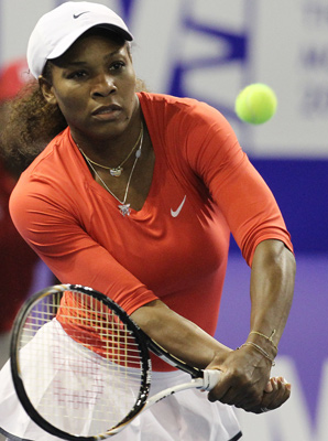 Serena Williams notched her fourth win in 13 exhibitions against her sister.