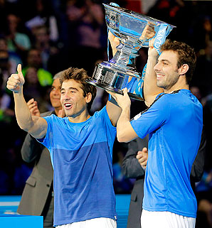 Marc Lopez (left) and Marcel Granollers celebrate their third title of the season.
