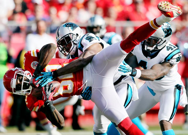 Panthers defensive back Josh Thomas sends Chiefs wide receiver Dwayne Bowe flying after Bowe made a catch. Bowe had four receptions, as his team won 27-21.
