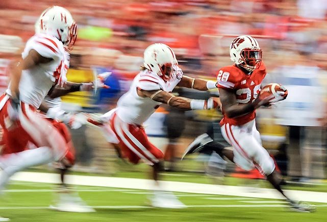 Wisconsin running back Montee Ball speeds past Nebraska's defenders on his way to a touchdown in the Big Ten Championship.