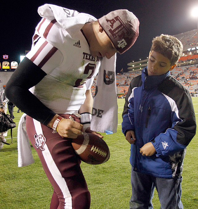 Manziel signs for a fan after Texas A&M dismantled Auburn, 63-21, in October.
