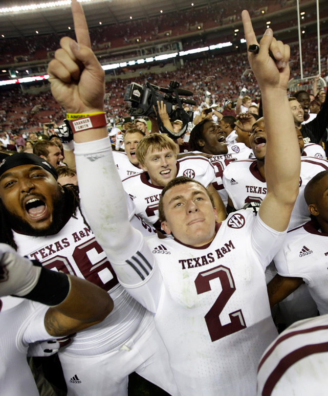 Manziel celebrates after the Aggies defeated top-ranked Alabama 29-24 at Bryant-Denny Stadium.