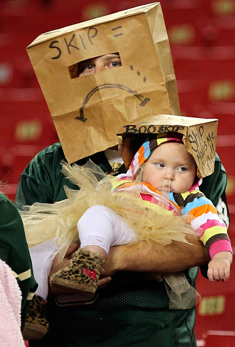 Bonding experience: Just a dad and his daughter with a bag on as the Pitt Panthers stampede their hapless Bulls, 27-3, at Raymond James Stadium in Tampa.