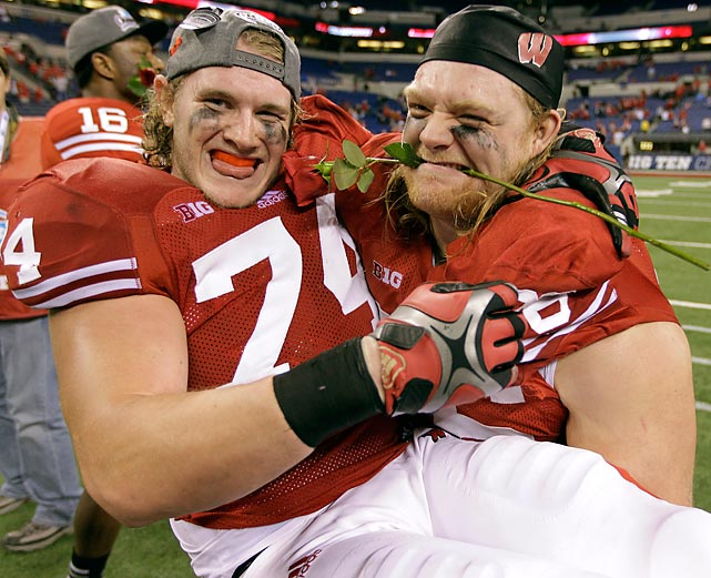 A lineman and his Beau shared a warm, romantic moment after their Badgers shucked the Cornhuskers, 70-31, to secure a Rose Bowl berth.
