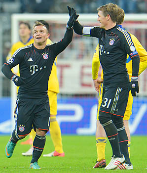 Bastian Schweinsteiger (right) and Bayern Munich won their group with 13 points.
