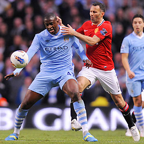 Yaya Toure (left) and Manchester City beat United by a combined 7-1 over two league matches last season.