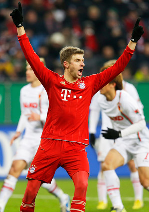 Bayern's Thomas Mueller celebrates after scoring a penalty in a 2-0 win.