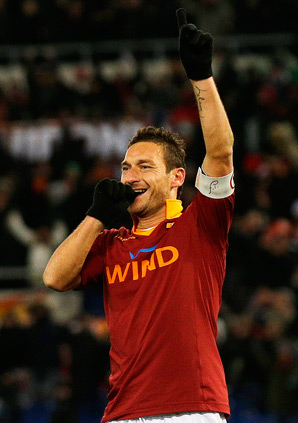 Roma captain Francesco Totti scored twice in a 4-2 victory.