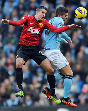 Robin van Persie and Manchester United moved six points clear of Sergio Aguero and Manchester City.