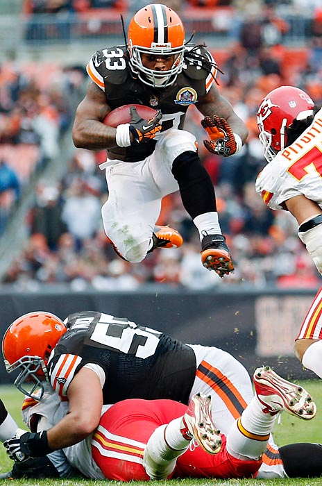 Browns' running back Trent Richardson hurdles a fallen Kansas City and Cleveland player. Richardson scored two touchdowns as Cleveland rolled over the Chiefs 30-7.