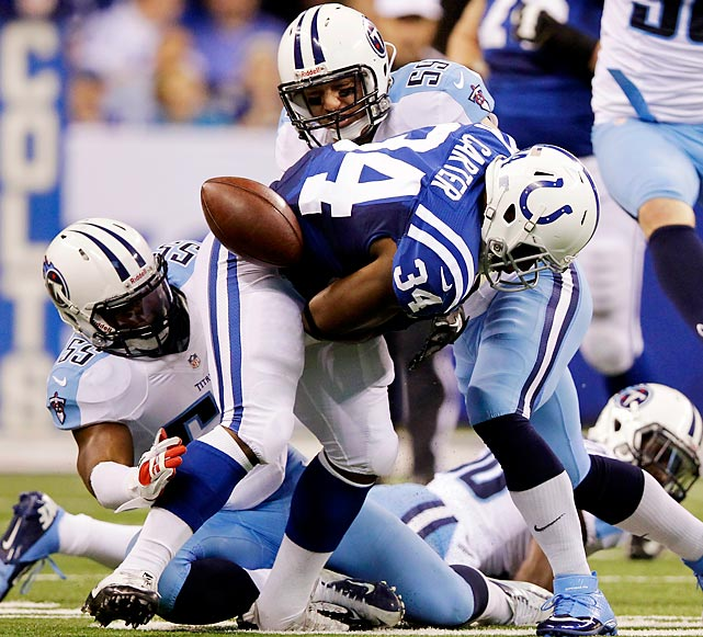 Delone Carter fumbles after being hit by the Titans' Tim Shaw. It was Shaw's first forced fumble of the season, but the Colts still won, 27-23.