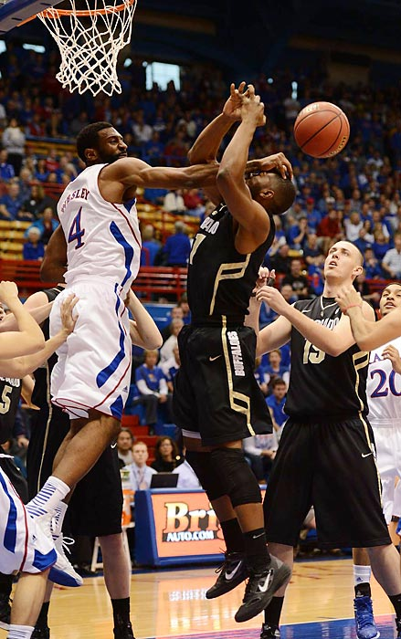 Kansas' Justin Wesley smacks the ball out of Jeremy Adams' hands. Wesley and the Jayhawks had an easy night against Colorado, which lost by 36 points.