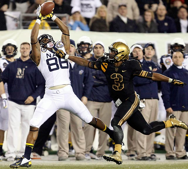 Navy receiver Brandon Turner didn't let Army defender Chris Carnegie's hand prevent him from making a catch in the fourth quarter. The catch helped the Midshipmen rally to a 17-13 win -- their 11th straight victory over their Army rivals.