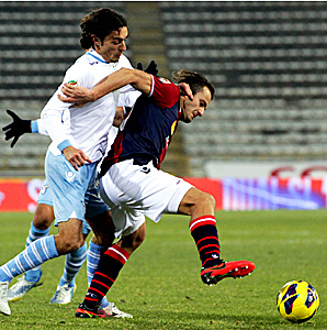 Bologna's Alberto Gilardino (right) had a shot blocked by Lazio goalkeeper Federico Marchetti in the final ten minutes of regulation.