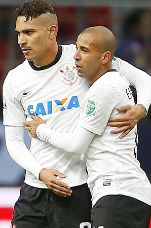 Paolo Guerrero (left) is congratulated by Emerson after scoring in Corinthians' win.