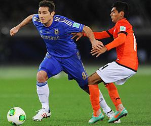 Frank Lampard dribbles away from Jesus Corona of Monterrey.