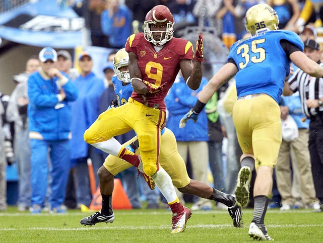 USC receiver Marqise Lee may be only a sophomore, but he has already made his mark in the Pac-12 record book. Lee had 16 catches for 345 yards against Arizona, demolishing the conference's old single-game record. By the end of the season he finished with 112 receptions for 1680 yards and 14 touchdowns.