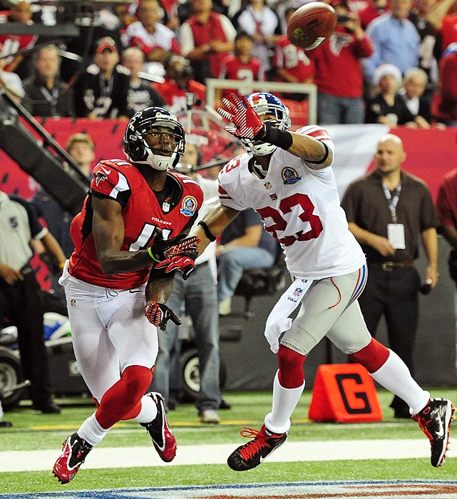 The Falcons' Julio Jones and the Giants' Corey Webster eye the ball in the end zone. Jones caught two touchdown passes in the 34-0 win.