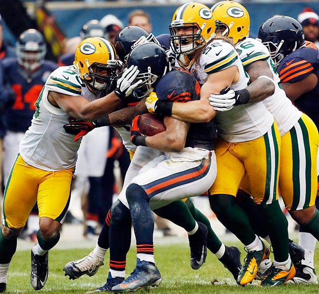Chicago running back Matt Forte gets smothered by Green Bay defenders. The Packers won the NFC North with the 21-13 victory.
