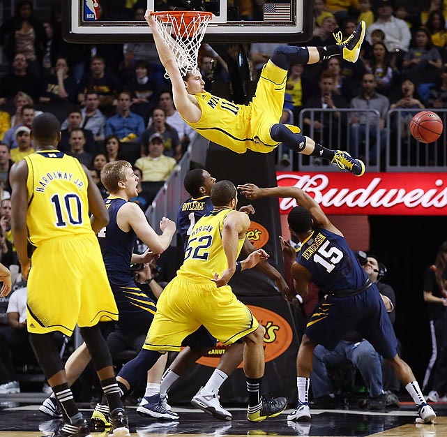 Michigan's Nik Stauskas watches his missed dunk float away against West Virginia. Luckily for him, the Wolverines still downed the Mountaineers 81-66.