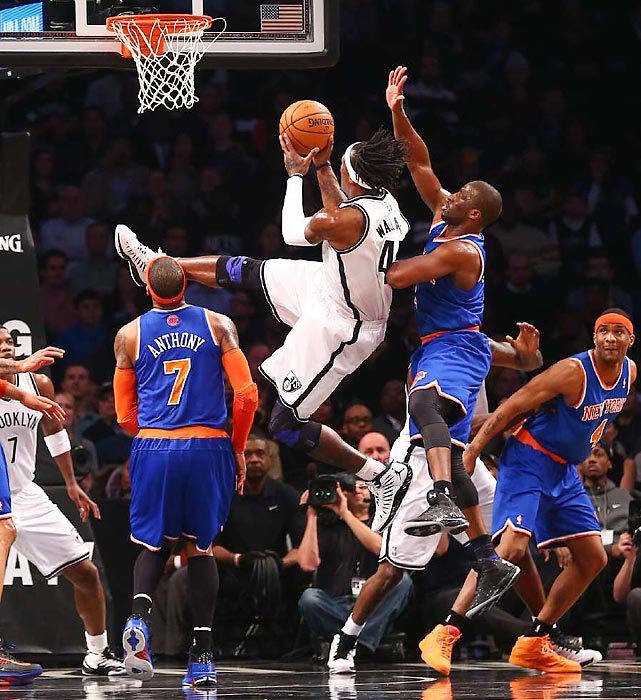 Brooklyn's Gerald Wallace goes up for a shot against Carmelo Anthony. The Knicks pulled out the win 100-97.