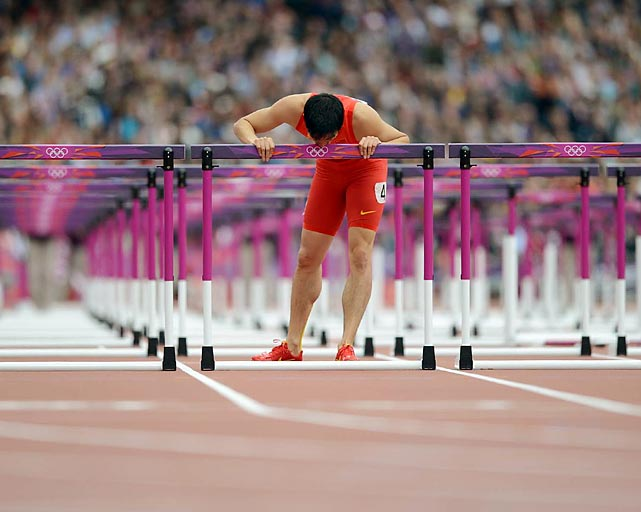 Chinese Olympian Liu Xiang reacts after crashing during the 110m hurdles heats in London.