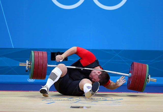 Defending Olympic weightlifting champion Matthias Steiner of Germany lost his balance while trying to lift about 432 pounds and was hit in the neck by the barbell. He got up on his feet and waved to the crowd but later withdrew from the competition.