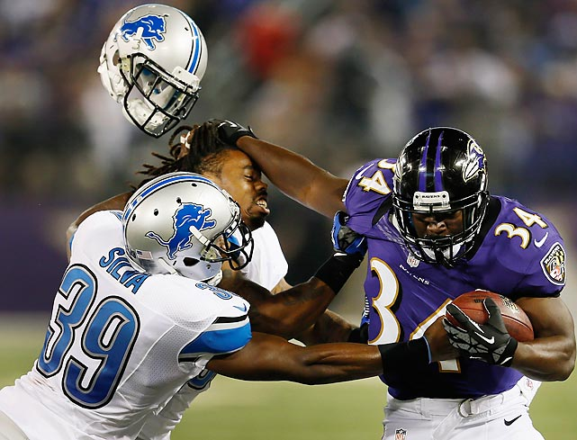 Detroit Lions' Jonte Green loses his helmet while trying to stop Baltimore's Bobby Rainey during a preseason game.