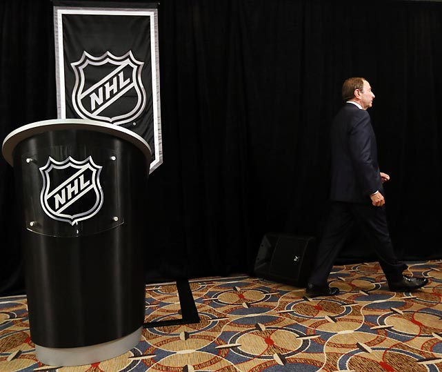 Commissioner Gary Bettman walks away from the podium after having announced to the media that the league would lock out its players if a new labor deal was not reached. Days later, Bettman and the league's owners did just that.