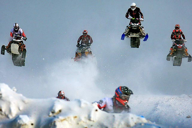 Four riders take to the air as they try to catch the leader during a Snowcross World Championship event in Russia.