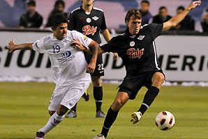 Claudio Bieler (left) struggles for the ball with Luciano Civelli during the Sudamericana Cup in 2011.
