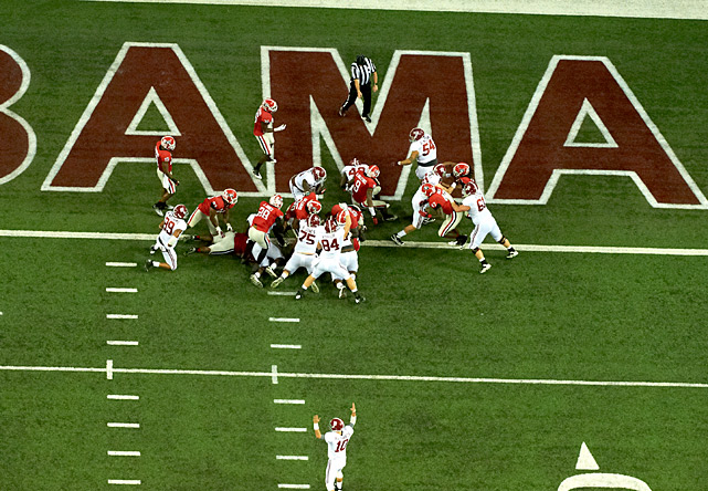 It was a game that will actually be talked about for ages. With a national title berth awaiting the winner, Alabama and Georgia played an uncharacteristically high-scoring SEC Championship, which made it all the more memorable. Alabama wide receiver Amari Cooper made one highlight reel catch, and eventually the game-clinching 45-yard touchdown reception with 3:15 remaining. Georgia quarterback Aaron Murray charged the Bulldogs 77 yards down the field in just over a minute, but his decision to not spike the ball proved costly in the end as wide receiver Chris Conley ended up with the ball in bounds as time expired. Alabama's 32-28 win guaranteed it a spot to play Notre Dame in the BCS National Championship.