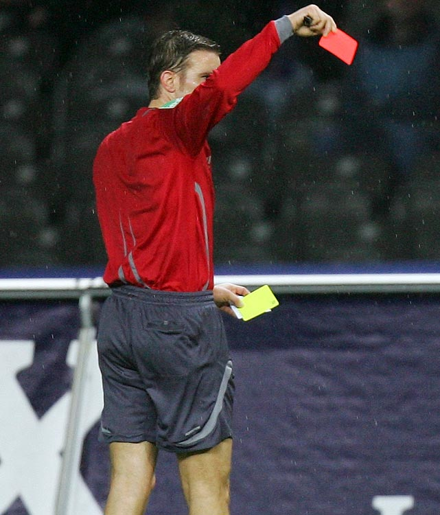 After being knocked unconscious on a play in a Belgian amateur soccer league match (suffering a concussion and three displaced vertebrae), midfielder Julien Lecomte was issued a yellow card for diving; then?because it was his second yellow of the game?given a red card while being carted off the pitch. <italics>March 19 issue</italics>