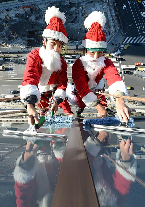 No time off for these guys. When they're not making toys, they're washing hotel windows in Tokyo.