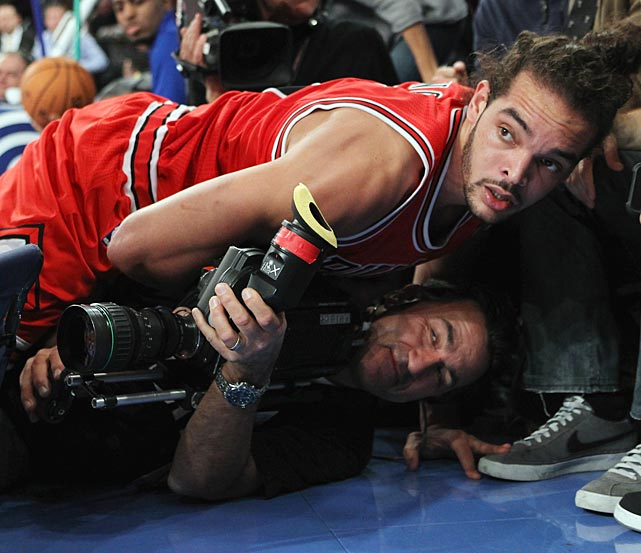 Joakim Noah of the Chicago Bulls landed on a TV camerman during second-quarter action of a game against the New York Knicks at Madison Square Garden.