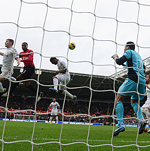 Patrice Evra (red) gave Manchester United a temporary 1-0 lead with his header in the 16th minute.