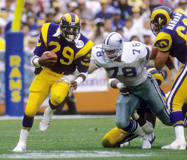 One year after breaking the NFL rookie rushing record with 1,808 yards, Eric Dickerson set the single-season record, which has now stood for 28 years.