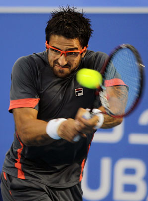 Janko Tipsarevic (above) beat Andy Murray 6-4, 6-3 in the opening match of the World Tennis Championship exhibition tournament.