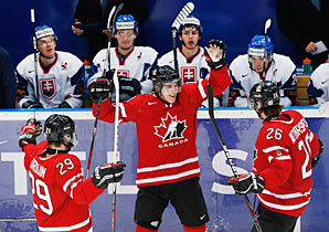 Ryan Strome (center) celebrates his third period goal that sealed Team Canada's win.