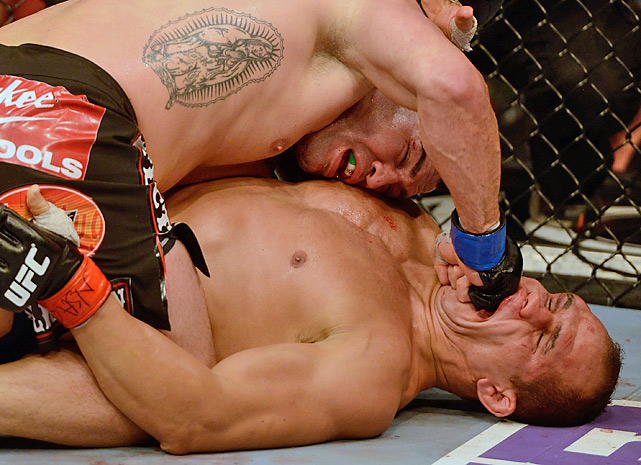 Cain Velasquez (top) got the better of Junior dos Santos during their heavyweight championship rematch. Velasquez regained the title by unanimous decision.
