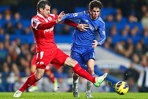 Ryan Nelsen (left) battles Oscar in QPR's 1-0 win over Chelsea.