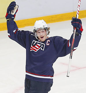 The U.S.' Jake McCabe celebrates his first goal against Canada in the semifinals.