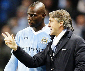 Mario Balotelli, Roberto Mancini and Manchester City are in second place in the Premier League.